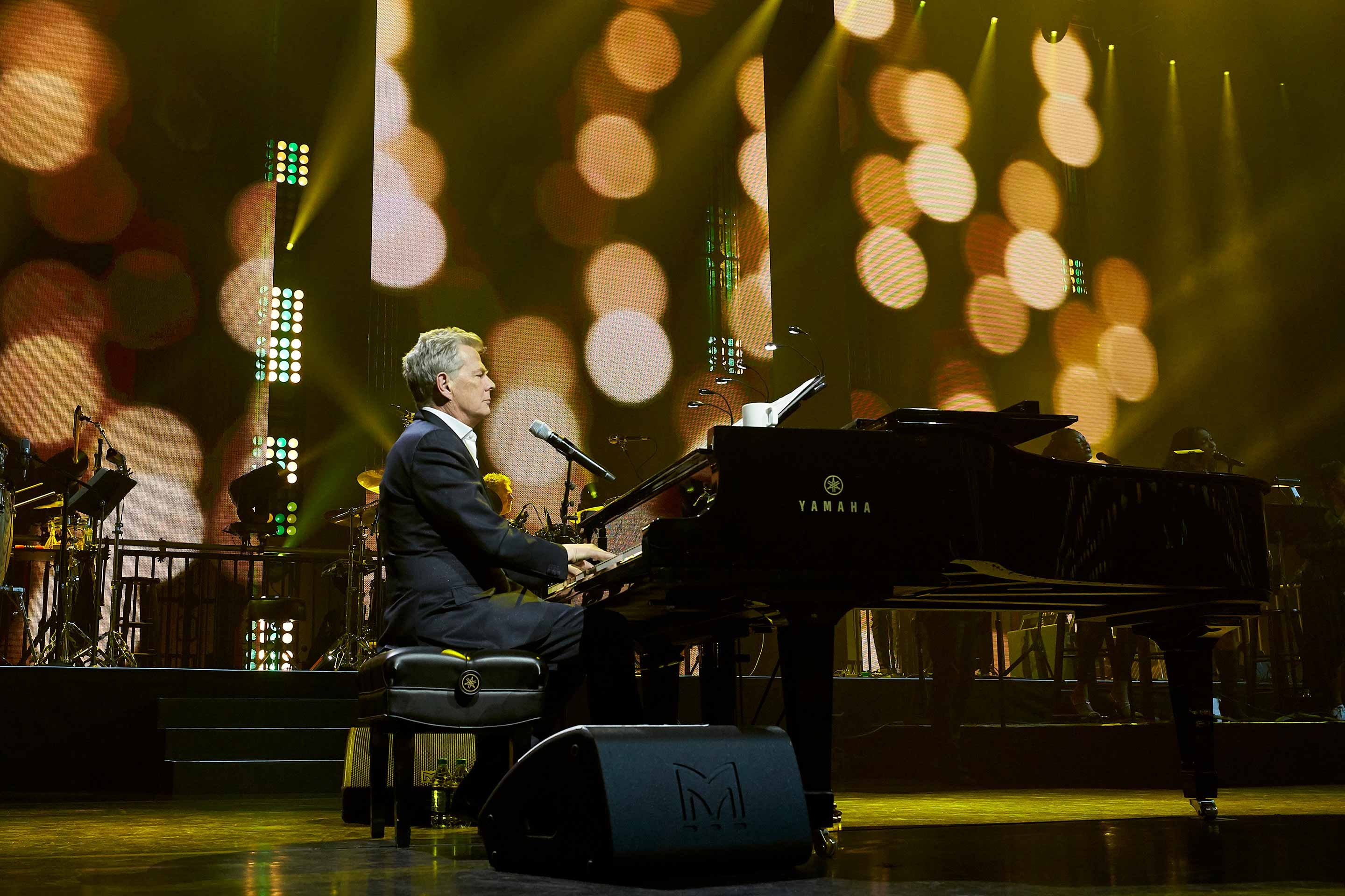 An XE500 stage monitor shown with David Foster at the closing concert for McDonald's 2018 Worldwide Convention