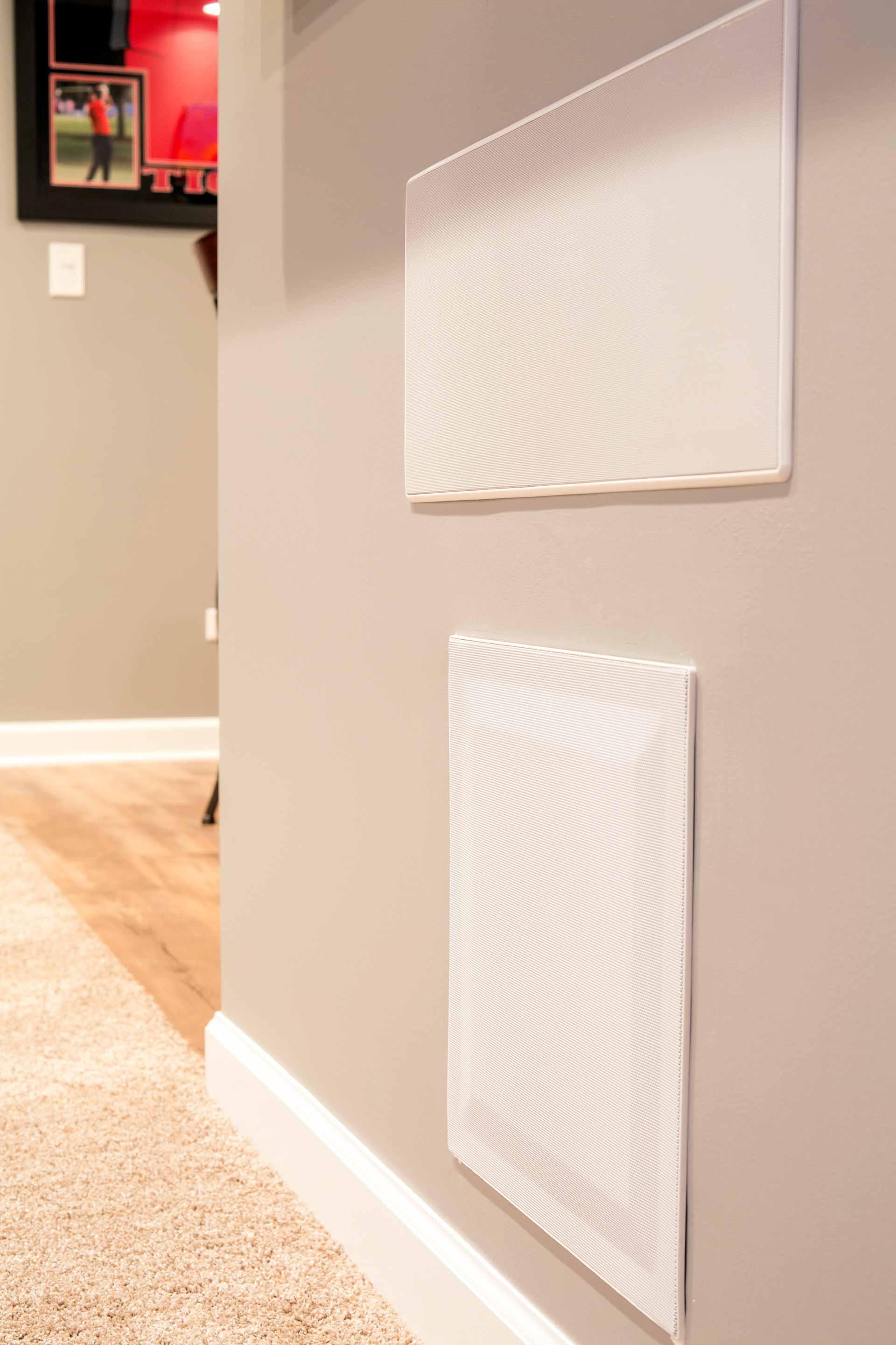 A Polk Audio 265-RT Vanishing In-Wall Loudspeaker with a Proficient Audio Systems IWS105 Inwall Subwoofer